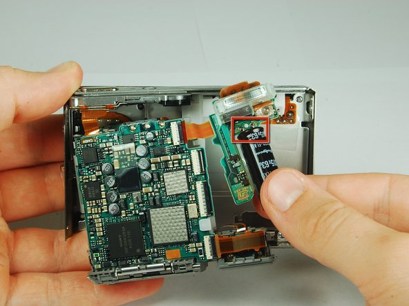 Image 3/3: The flash module is shown on the right hand side.
