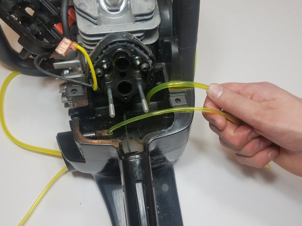 Feed the fuel line through the gas tank while pulling the wire as in the previous step