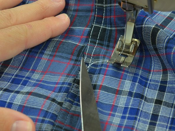 You do not need to pin this seam, because the first seam will hold the garment in place.