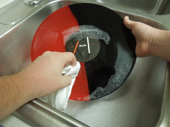 Make sure the whole surface of the record is wet.