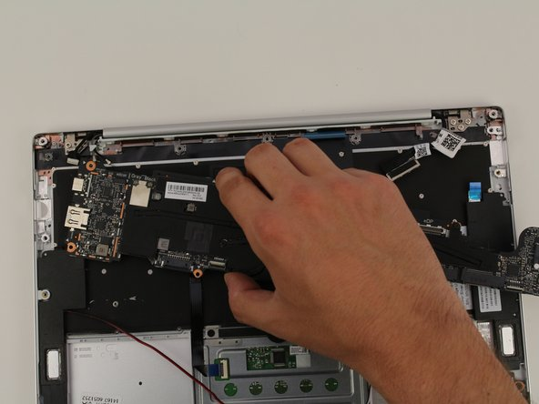 Gently lift the motherboard out by hand.