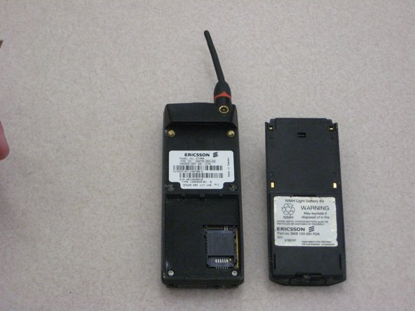 Image 1/2: To remove the SIM card, using your index finger, carefully lift up and rotate the plastic casing.
