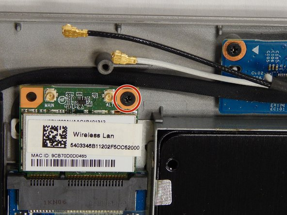 Remove the single 3 mm screw located on the top-right side of the Wi-Fi card using the Phillips #0 screwdriver.