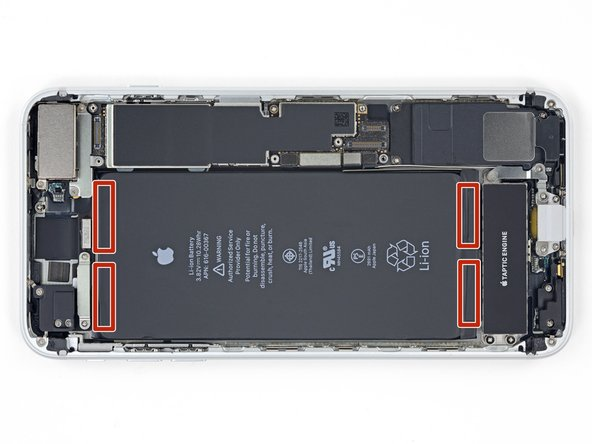 The iPhone 8 Plus's battery is secured by four pieces of stretch-release adhesive—two at the top, and two at the bottom.