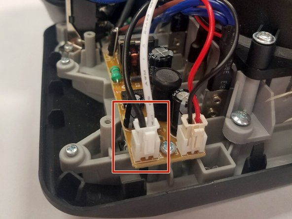 To replace the LED, unplug the white jack with the black and white cords from the bigger tan circuit board.