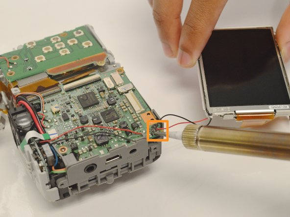 Carefully disconnect the LCD Screen ribbon cable away from its ZIF connector with your thumb and index finger.  You must make sure to have your thumb and index finger cover as much of the ribbon's width and as close to the ZIF connector as possible without touching  the motherboard while pulling the ribbon out. line.