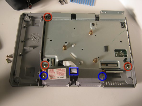 Replace the top shield, and secure with the 3 screws indicated.