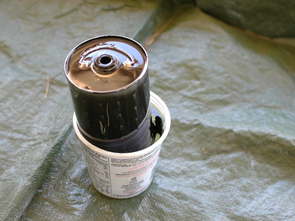 Make sure to keep the oil filter in a suitable container. It will slowly drip dirty oil.