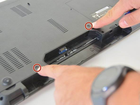 Use the Philips screwdriver to remove the two screws at the bottom of the cover.