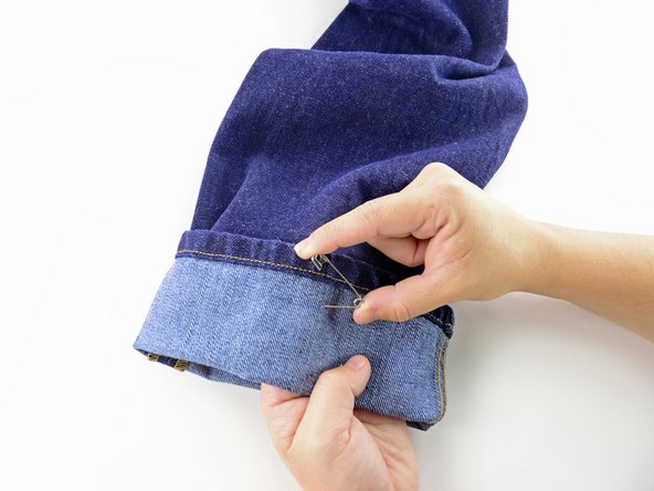 Image 2/3: Unpin the cuff of the jeans.