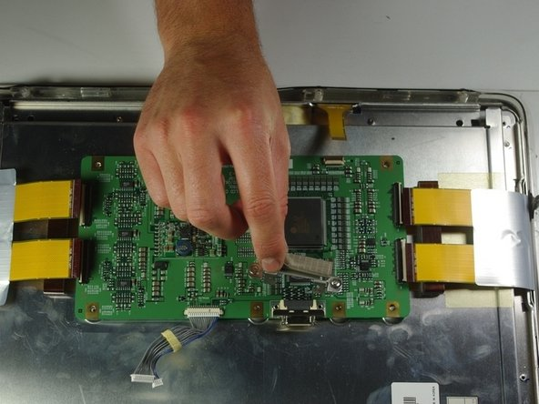Image 1/2: Remove the circuit board from the right side of the unit by gently lifting it out.