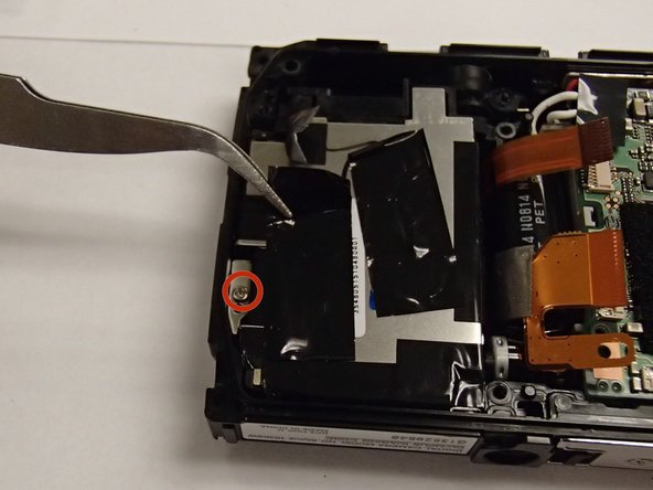 Image 1/3: Remove PH00 screw and the metal washer plate beneath it