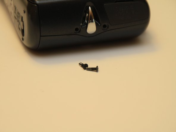 Remove the two coarse thread screws on the side of the device, to the left of the camera lens.