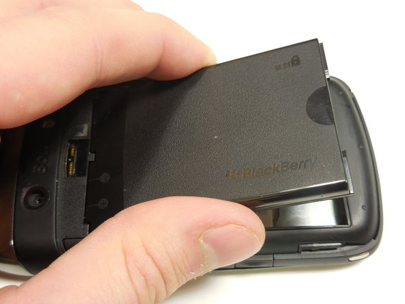Once the battery is angled up, pull it away from the top of the device.