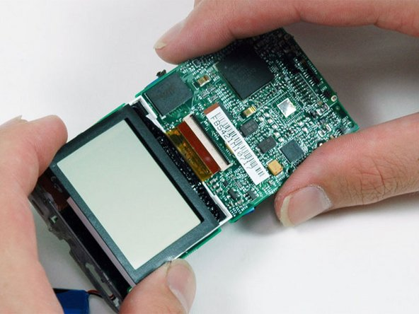 Image 1/1: Carefully lift the display up and slide it out of its connector.