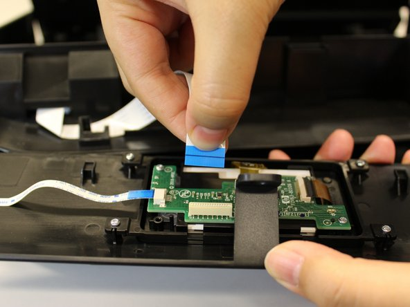 Remove the connector that is attached to the screen's circuit board by pinching the blue part of the connector with two fingers and pulling it away from the circuit board.