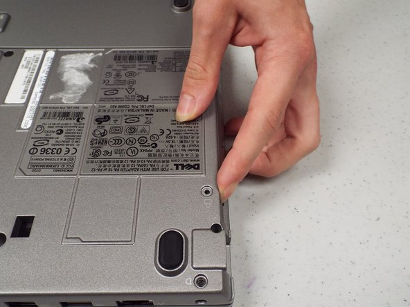 Remove the CD/DVD Drive by pushing on the button under the drive.