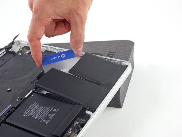 Leave the plastic card underneath both battery cells (or flip them over) to prevent them from re-adhering as you proceed to the next step.