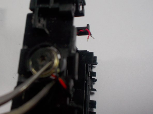 Image 2/2: Remove speaker with given tweezer tool and replace