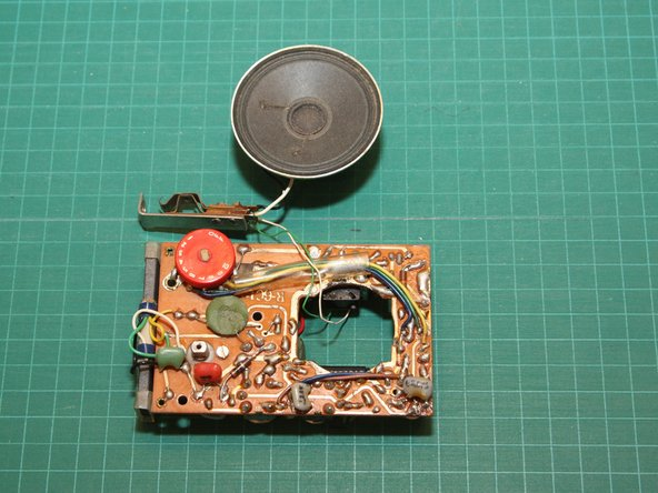 Image 1/2: Notice that there are components mounted on both sides of the circuit board. Perhaps the resistors and capacitors on the solder-side were a last minute design change?