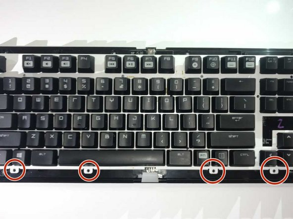 Use a Philips #1 Screwdriver to remove the four screws located below the keys.