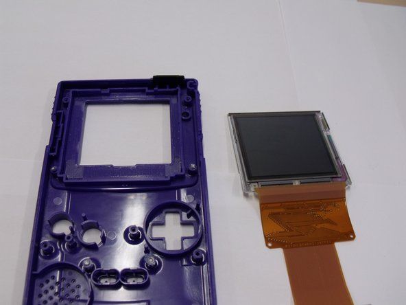 Pull the screen out of the game boy and take the front panel of plastic away and move it to the side.