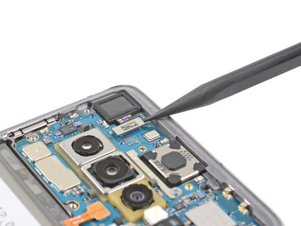 Use the point of a spudger to pry up and disconnect the front-facing camera connector from its motherboard socket.