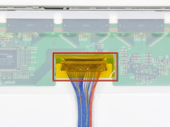 If present, remove the strip of tape covering the display data cable connector.