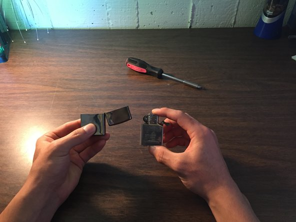 Open your Zippo lighter and take the inside component out of the shell simply by pulling it out.