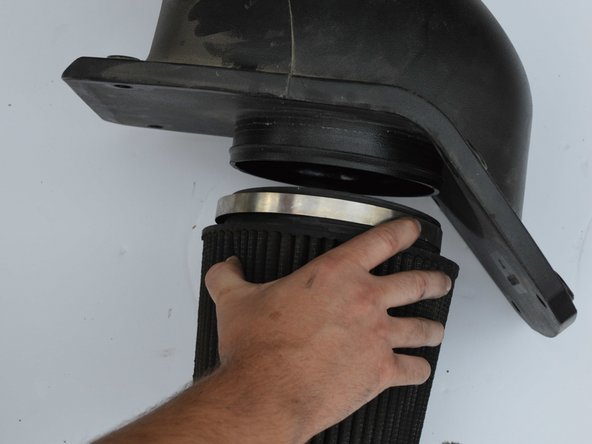 Pull air filter from housing.