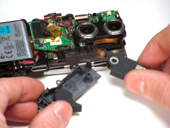 Carefully lift the USB drive off of the peg that it is attached to.