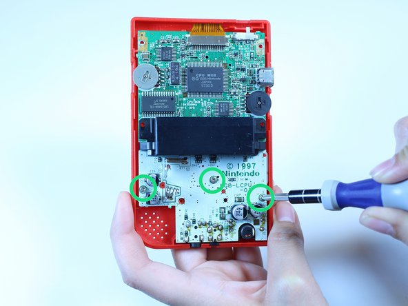 Use a Phillips #1 screwdriver and turn counterclockwise to remove the three screws on the motherboard.