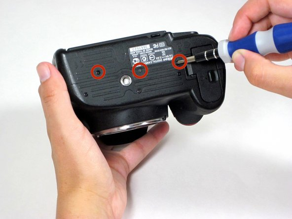 Using a Phillips #00 screwdriver, remove 5 exposed screws from around the perimeter of the camera.