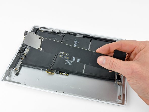 Image 1/1: Remove the logic board from the iPad 2.