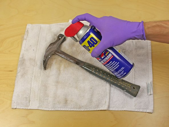 Spray the rusty areas of the tool with a generous amount of WD-40.