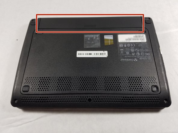 Place the laptop upside down on a flat surface so you can see the battery (marked in red).