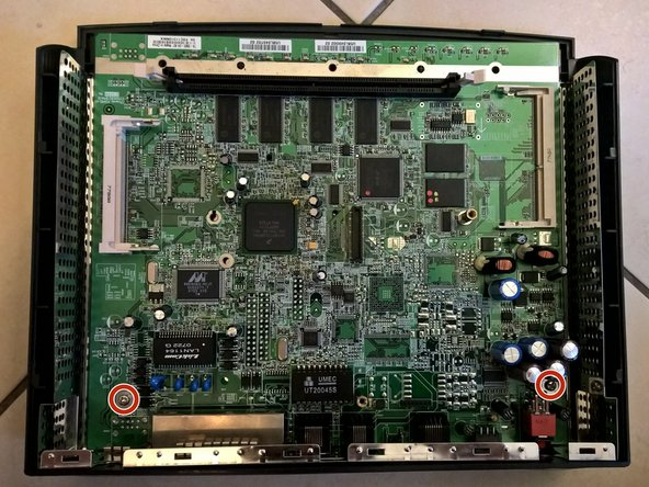 Use the Phillips #1 Screwdriver to remove the two screws holding the motherboard.