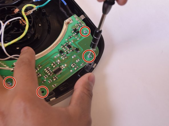 Begin detaching the circuit board by removing four rounded top (12mm) Philips head screws (one from each corner).