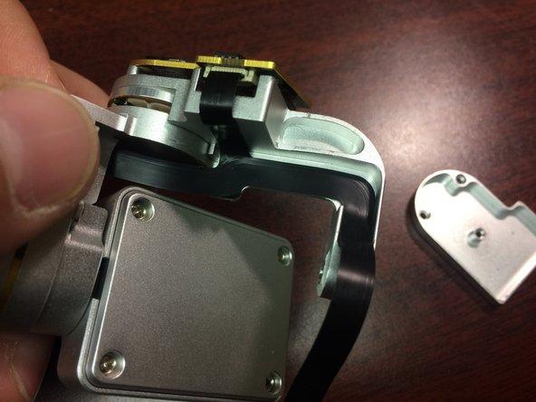 Image 1/3: Carefully peel it off the yaw arm.