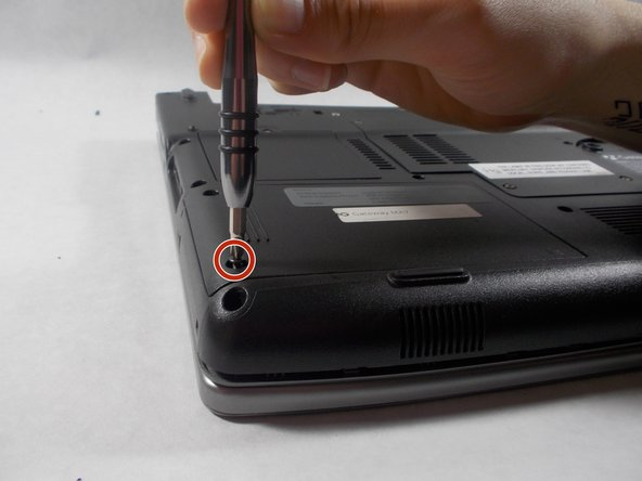 Remove the two 6 mm Phillips #0 screws from the back of the hard drive cover.