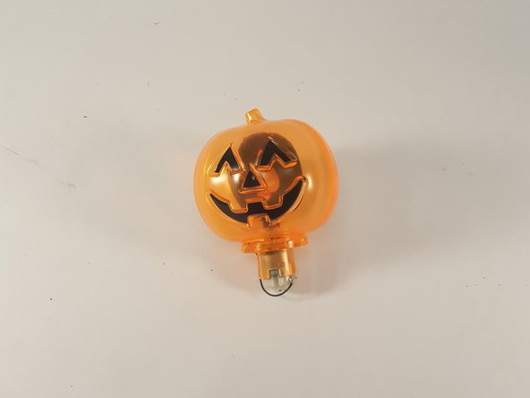 First me and My Team members Found a tear down to use for our project  . There was a pumpkin halloween toy with a light inside and we decided to tear it down and discover whats inside . So we decided to take off the bottom peice .