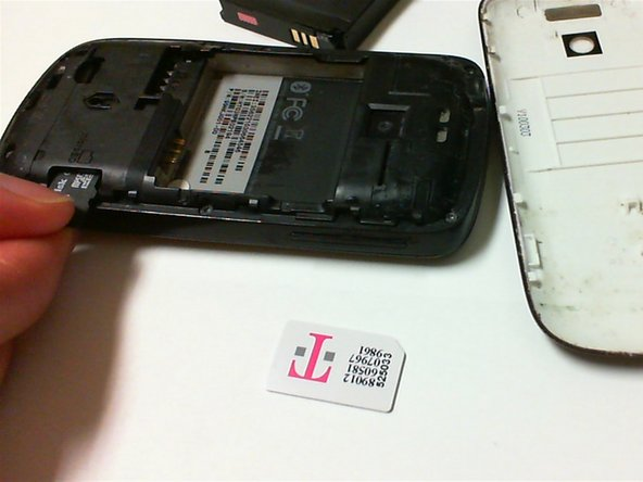 Press the SD card in, and the SD card should pop loose.