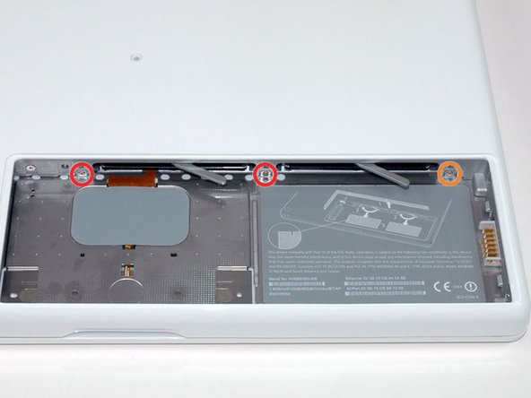 Remove the following 3 screws from the rear wall of the battery compartment: