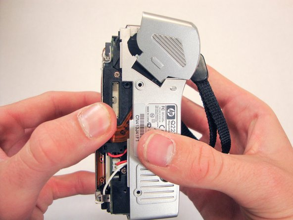 Image 1/1: Pull the bottom half of the inner camera out of case about half an inch. This may be difficult and force is necessary.