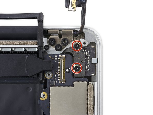 Remove the two 4.0 mm T5 Torx screws from the MagSafe 2 board.