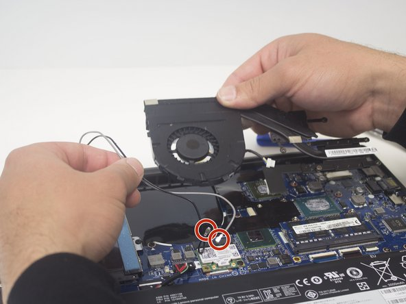 Gently, remove the black and white wires surrounding the fan.