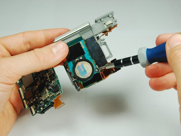 Image 2/3: Use a PH00 screwdriver to remove the 2.9 mm phillips screw connecting the speaker to the battery pack.