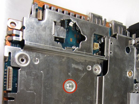 Image 1/3: Remove the screw on top and the four screws on the bottom with a #1 Phillips screwdriver.