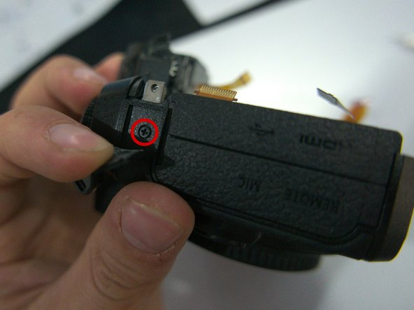 Photo 1: Remove the 4 mm screw beneath the rubber below the left strap lug