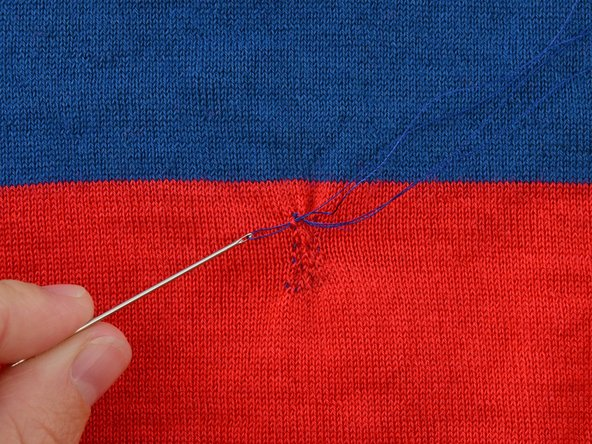 Pull the needle through until the thread is taut.